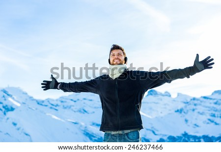 Handsome guy smiling in the Alps. - stock photo
