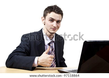 handsome guy with a laptop at a desk