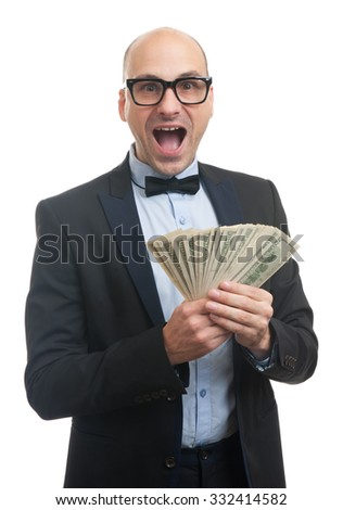 Handsome guy with glasses and bow-tie holding a lot of money - stock photo