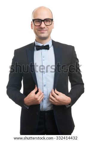 Handsome guy with glasses and bow-tie. Studio shot - stock photo