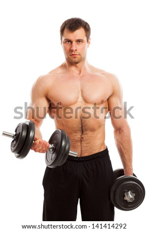 Handsome guy working out with dumbbells isolated over white background - stock photo