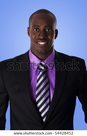 Handsome happy African American corporate business man smiling, wearing black suit with purple shirt and striped necktie,  isolated. - stock photo