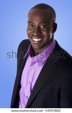 Handsome happy African American corporate business man smiling, wearing black suit with purple shirt,  isolated. - stock photo
