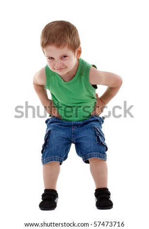 Handsome happy boy with hands on hips over white, with copy space - stock photo