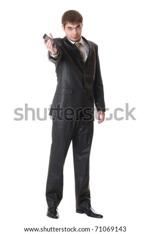Handsome happy businessman holding cell phone isolated on white background - stock photo