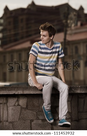 Handsome happy man outdoor - stock photo