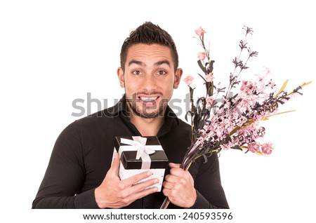 handsome happy young man holding a flower bouquet and gift box isolated on white - stock photo