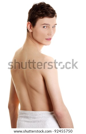 Handsome, happy young man with the towel around his waist. Isolated on white