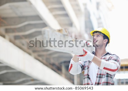handsome hard worker people portrait at concstruction site - stock photo