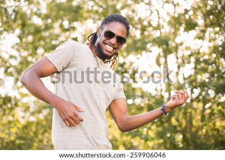 Handsome hipster in the park on a sunny day - stock photo
