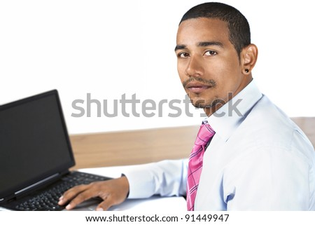 Handsome hispanic office man looking up with serious expression - stock photo
