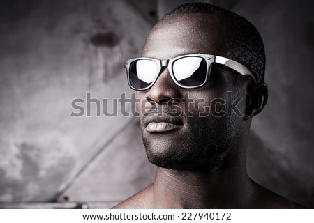 Handsome in sunglasses. Close-up of handsome young shirtless African man in sunglasses  - stock photo