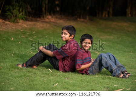 Handsome Indian boys outdoor smiling - stock photo