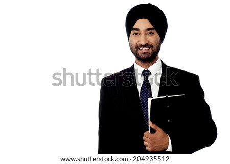 Handsome indian businessman holding a folder - stock photo