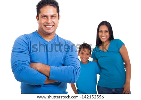 handsome indian father with arms crossed in front of family