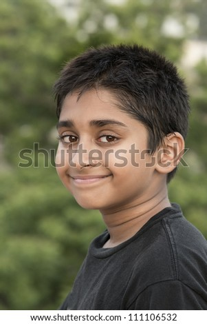 Handsome Indian toddler standing outdoor smiling - stock photo