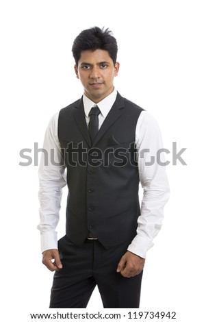 Handsome Indian young businessman looking to the camera. - stock photo