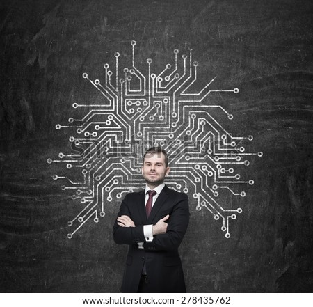 Handsome information technology specialist is thinking about optimisation of the business process' structure. Microchip sketch behind the standing person. - stock photo
