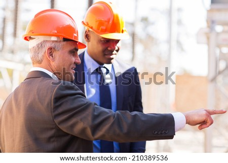 handsome inspectors working in electrical power station