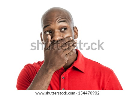 Handsome late 20s black man covering mouth with hand isolated on white