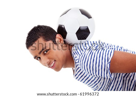 handsome latin boy holding a soccer ball, isolated on white, studio shot - stock photo