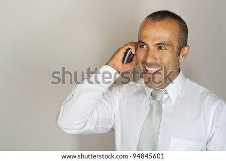 Handsome Latin Guy on Phone - stock photo