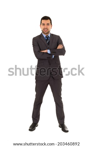 handsome latin man standing crossing arms wearing grey suit isolated on white