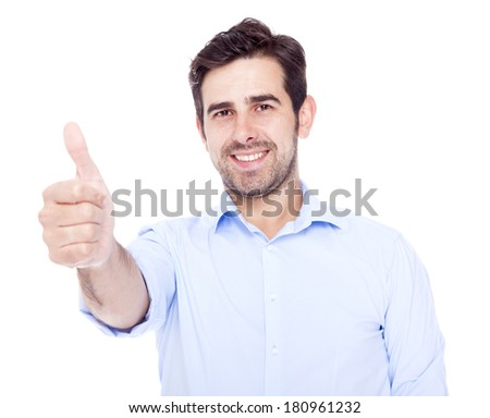Handsome latin man thumbs up over a white background