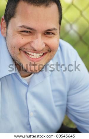 Handsome Latino businessman smiling - stock photo