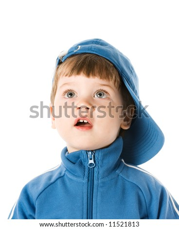 Handsome little boy looking at something. Isolated on white background - stock photo