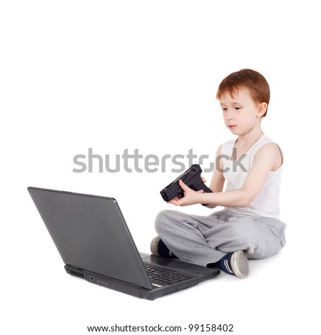 handsome little boy playing computer game with the pistol - stock photo