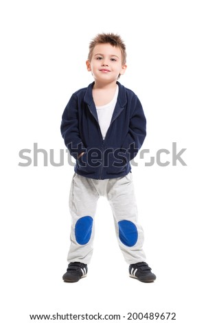 Handsome little boy posing in sport clothes. Isolated on white - stock photo