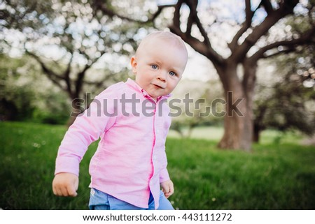 Handsome little man in a pink shirt - stock photo