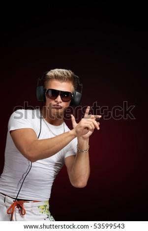 Handsome male dj - stock photo