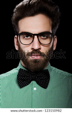Handsome male in glasses and bow tie - stock photo