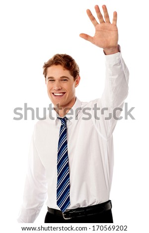 Handsome male manager waving to his colleague - stock photo