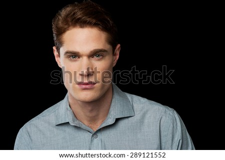 Handsome male model looking at camera
