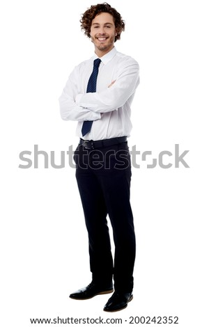 Handsome male professional posing with crossed arms - stock photo