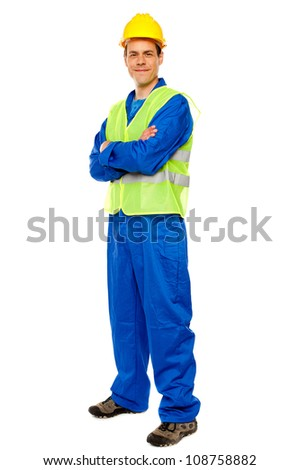 Handsome male repairman posing in style, full length portrait - stock photo
