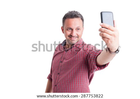 Handsome male taking a selfie with smartphone