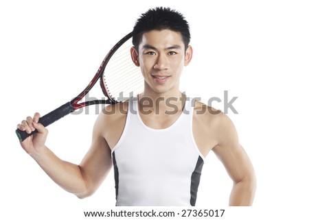 Handsome male tennis player isolated in white - stock photo