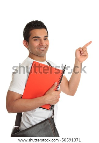 Handsome male university or college student points his finger to your message or slogan - stock photo