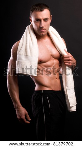 Handsome man after a shower with a towel - stock photo