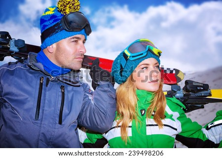 Handsome man and beautiful woman enjoying alpine ski resort, portrait of a nice couple playing winter sports, active lifestyle people, family travel to Europe on Christmas holidays - stock photo
