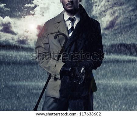 Handsome man and the autumn rain - stock photo