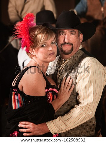 Handsome man and woman in old west costumes - stock photo