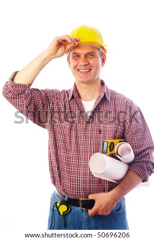 handsome man - builder with drawings smiles and adjusts his helmet hand - stock photo