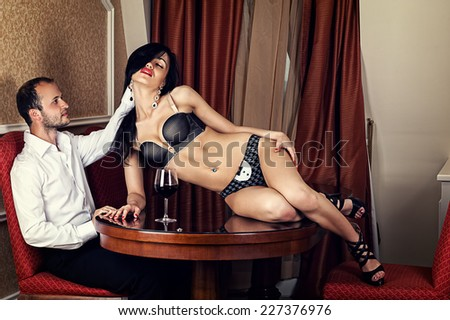 handsome man caressing hand hair attractive woman - stock photo