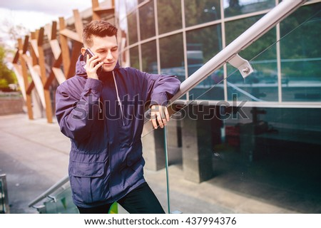 Handsome man cell phone call smile outdoor city street, Young attractive businessman casual blue shirt talking - stock photo