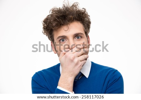 Handsome man covering his mouth over white background - stock photo